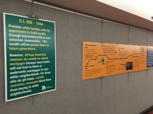 Posters about fair housing history at the Legislative Office Building concourse