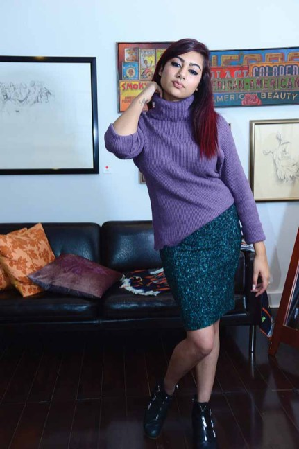 Model Rozana Tamis wears some of the fashions from Workspace Collective in Danbury. The project specializes in sustainable fashion. Sweater: Mara Women- Handwoven in Moldova Skirt: A. Bernadette - upcycled materials from Uganda