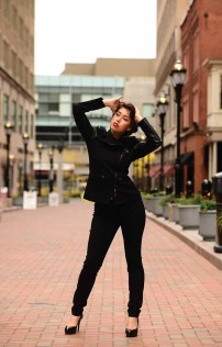 Model Jade Soto wears fashions available at Stackpole Moore Tryon in Hartford. She is photographed on Pratt Street in Hartford by Mike Chaiken.