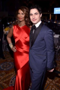 NEW YORK, NY - FEBRUARY 08: Model Iman (L) and designer Zac Posen attend as Moet & Chandon Toasts to the amfAR New York Gala At Cipriani Wall Street at Cipriani Wall Street on February 8, 2017 in New York City. (Photo by Bryan Bedder/Getty Images for Moet & Chandon) *** Local Caption *** Iman;Zac Posen
