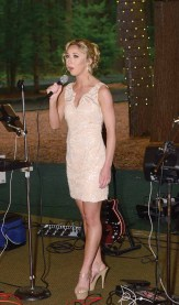 Miss Connecticut Eliza Kanner sings 'God Bless America' at the send off party for Miss Connecticut's Outstanding Teen Brooke Cyr.