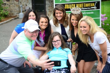 Emma Goldsberry, seated, poses for a selfie with her father Jonathan Goldsberry, left, mother Amy Goldsberry, Miss Connecticut's Outstanding Teen Brooke Cyr, New Britain Mayor Erin Stewart, Miss America Cara Mund, and Miss Connecticut Eliza Kanner.
