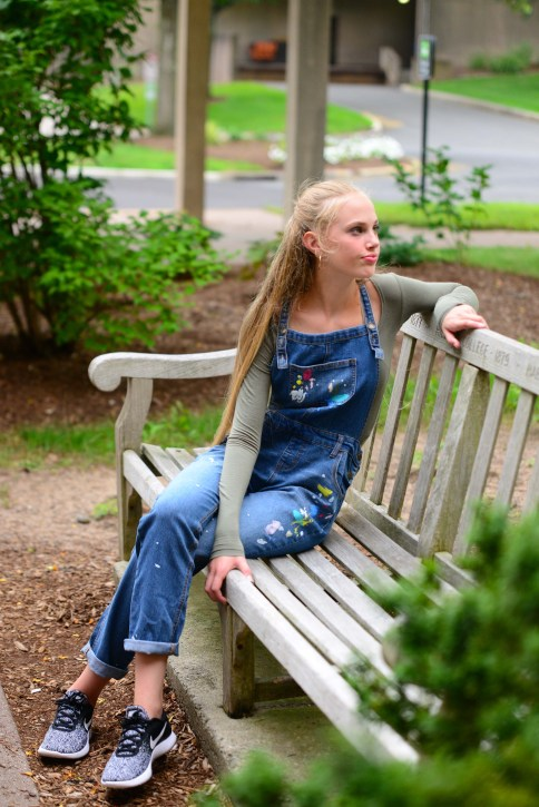 Model Caelyn Calhoun wears a pair of denim overalls from Target's Cat and Jack. Top and athletic shoes are the model's own.