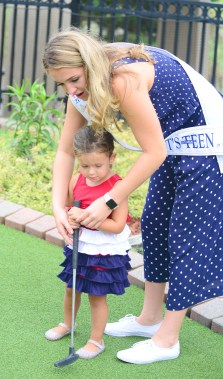 Miss Connecticut's Outstanding Teen Morgan Mancini offers some mini-golf wisdom.