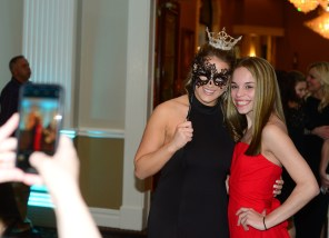 Miss Connecticut's Outstanding Teen Morgan Mancini, left, facing the camera, poses with one of her guests at the Masquerade Ball April 18 at La Bella Vista in Waterbury.