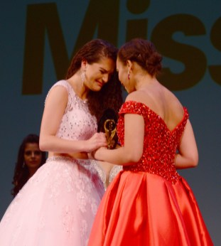 Lindiana Frangu, left, and Rielley Coles stand centerstage as the top two contestants at the Miss Connecticut Scholarship Competition.