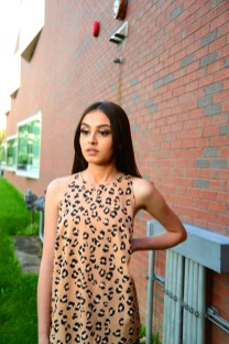 Model Iraima Lopez wears a New Day halter top in cheetah print from Target (Target.com).