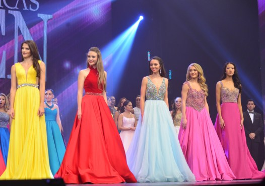 Payton May, center, in her powder blue evening gown.