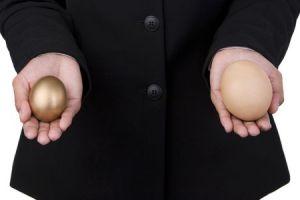 Small golden egg and big regular egg