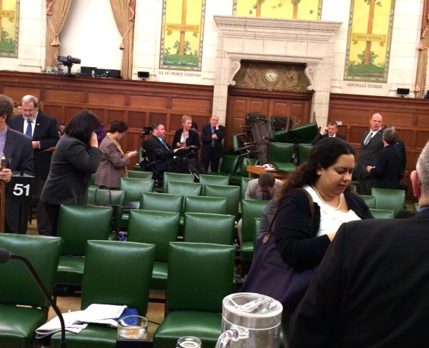 MPs block the door with chairs during a caucus meeting on Parliament Hill in Ottawa, Wednesday, Oct. 22, 2014. (Conservative MP Nina Grewal)