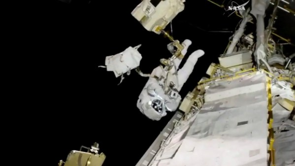 Spacewalking astronaut copes with frayed tether, bad ...