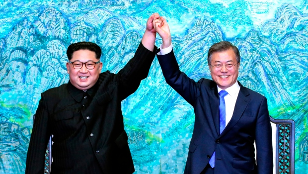 Kim Jong Un, left, and Moon Jae-in