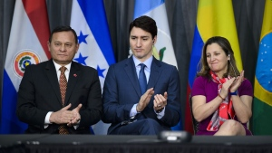 Peru's Minister of Foreign Affairs Nestor Popolizio Bardales, left, Prime Minister Justin Trudeau, middle, and Minister of Foreign Affairs Chrystia Freeland look on as Venezuelan Opposition Leader Juan Guaido (not pictured) delivers brief remarks via video link at the opening session of the 10th ministerial meeting of the Lima Group in Ottawa on Monday, Feb. 4, 2019. (THE CANADIAN PRESS/Sean Kilpatrick)