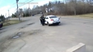 This still image taken from video appears to show the mass killer as he impersonated police in Nova Scotia on April 19, 2020. (Facebook)