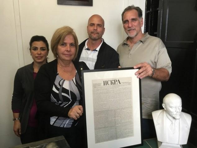 Rene, Gerardo, Adriana and Olga at the Marx Memorial Library with an original copy of Iskra, Spark