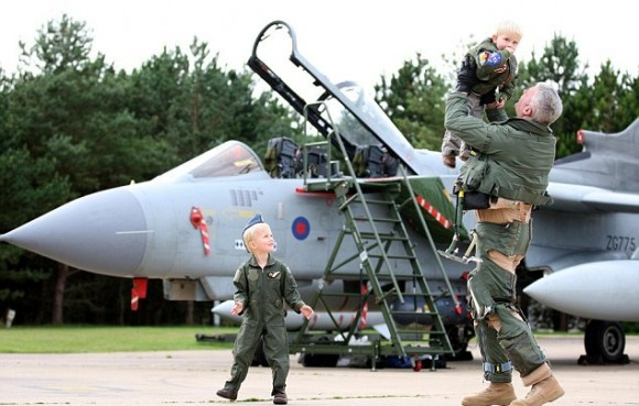 daddy-boys-wing-commander-andy-turk-from-9-squadron-is-greeted-by-his-two-children-on-his-return-to-raf-marham-kings-lynn-after-returning-from-service-in-libya1