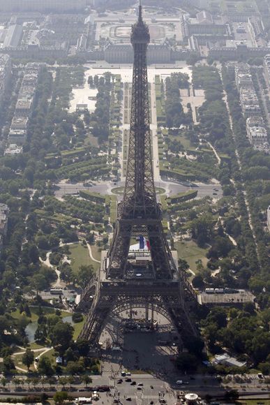 An aerial view shows the Eiffel Tower and the Champ de Mars in Paris