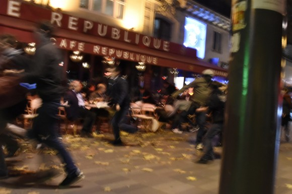 People run after hearing what is believed to be explosions or gun shots near Place de la Republique square in Paris on November 13, 2015. At least 18 people were killed in several shootings and explosions in Paris today, police said.  AFP PHOTO / DOMINIQUE FAGET        (Photo credit should read DOMINIQUE FAGET/AFP/Getty Images)