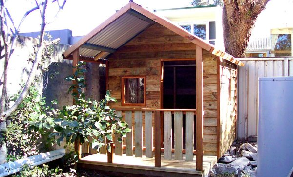 small cubby with verandah 2.2m x 1.8m, x2 perspex windows, stained trim $1350 with accessories