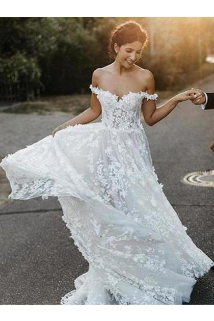 estido de novia con hombros descubiertos