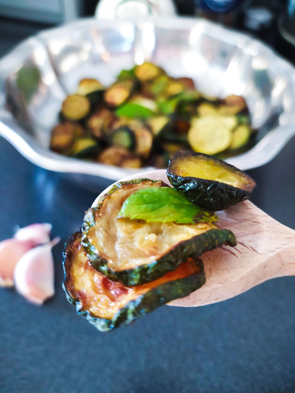 zucchini alla scapece close up with wooden spoon