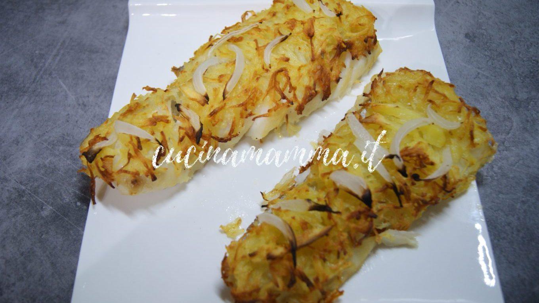 Tranci di merluzzo in crosta di patate e cipolle