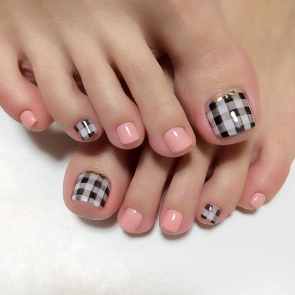 A Cute Gingham Themed Toenail Art Design The Uses Black And White Polishes