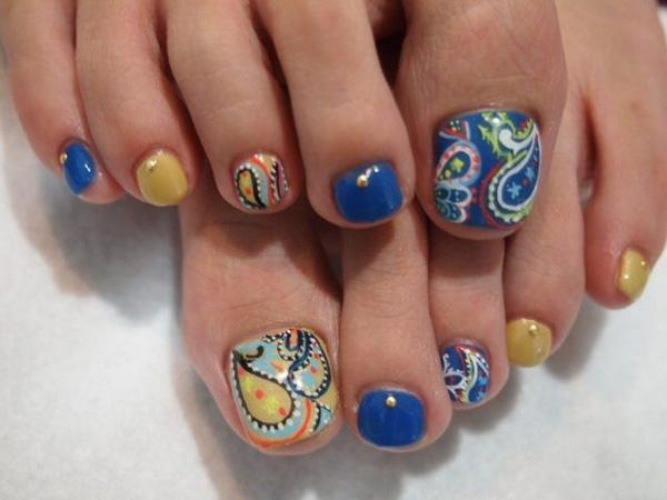 A Cool Looking Abstract Themed Toenail Art Design Making Use Of Plimenting Colors Such As