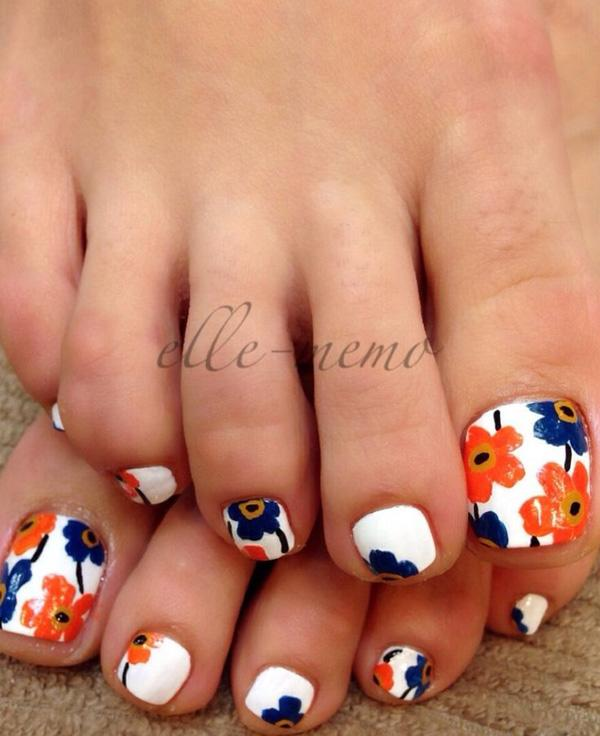 A Cute And Colorful Flower Inspired Toenail Art Design Using White As The Base Coat