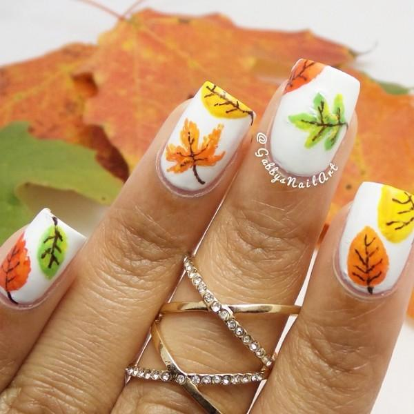 Add Creativity To Your Nails With This Multi Colored Leaf Themed Fall Nail Art Design
