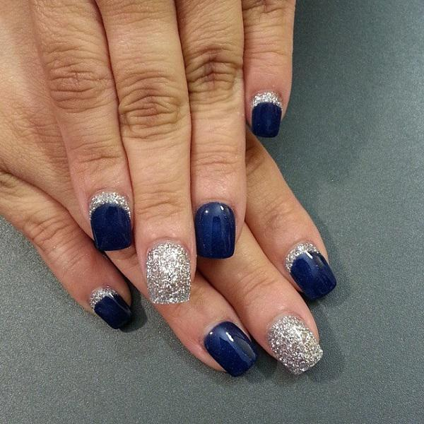 A Nail Art Design In Blue Matte Polish Adorned With Silver Dust On Top Cut Out