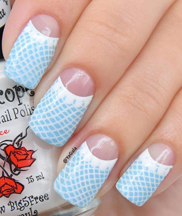 Here's a little mermaid (just because it looks like fish scales) nail art design for you in sky blue and white.