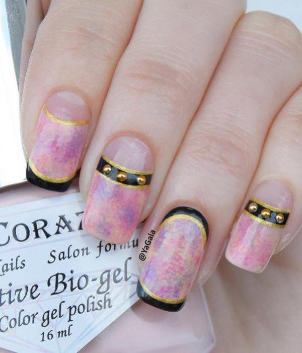If this isn't a thing of beauty, I don't know what beauty means. The marbled pink and purple base is accentuated with black French tip and half moon outlines with thinner gold nail polish along the outer lines. Plus add those old studs and you're hands are divine.