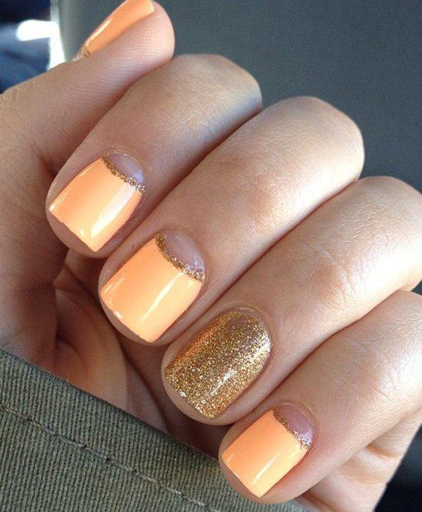Orange and gold could go well with each other. But just thin lines of gold only to separe orange to the half moon design. The full gold finger is merely for accenting the whole look.