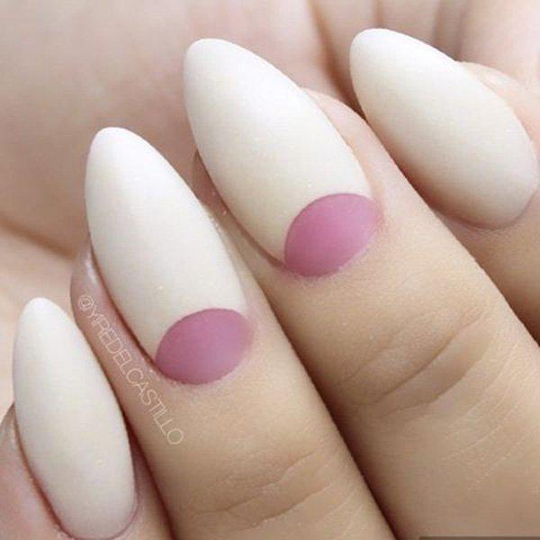 This coffin-shaped nails with white matte nail polis gives an elegant finish with a naked Half moon design.
