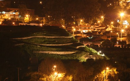 Pumapungo temple earthworks at night.