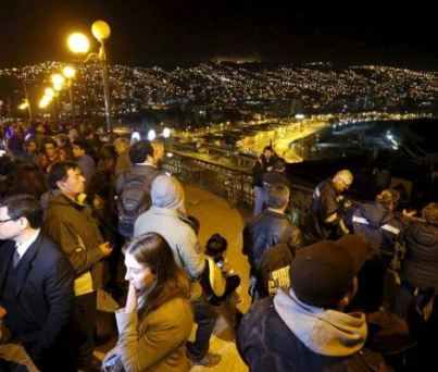 Residents of Valpariso, Chile, gather on a hill waiting for the Tsuanmi.