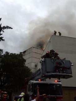 Smoke billows from the top of the theater production tower.