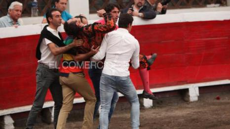Spanish matador David Fadila is carried from the bull ring in Quito on Saturday.