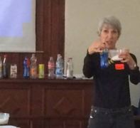 Nutritionist Susan Burke March demonstrates the amount of sugar contained in a bottle of soda.