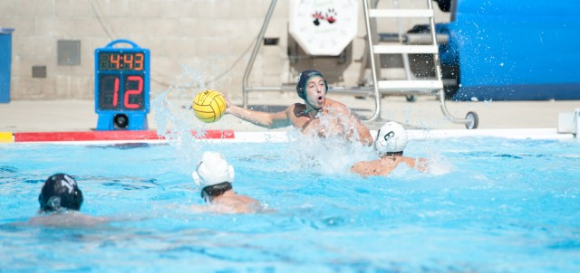 Austin Barton taking on the Golden West College Rustlers during a Cuesta waterpolo match. Photo courtesy of Ritchie Bermudez / Cuesta Athletics