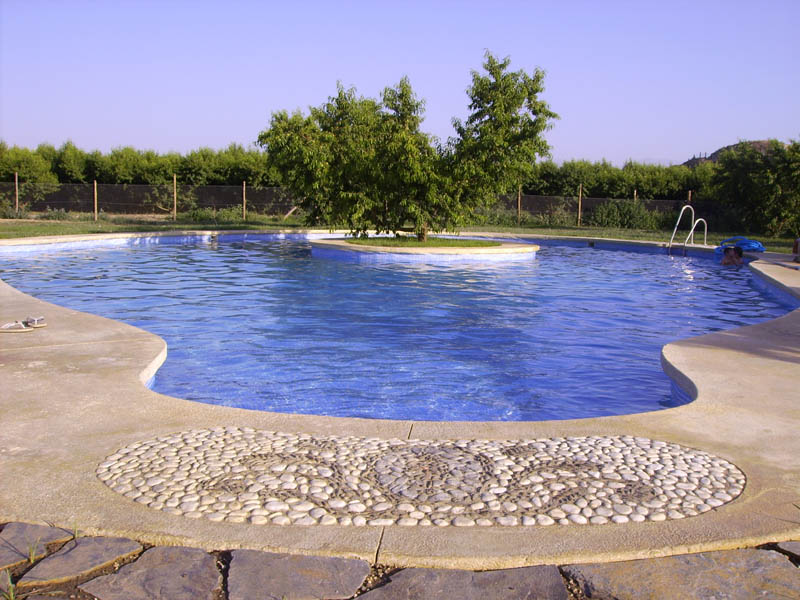 https://i1.wp.com/www.cuevaslachumbera.com/galeria/piscina2.jpg