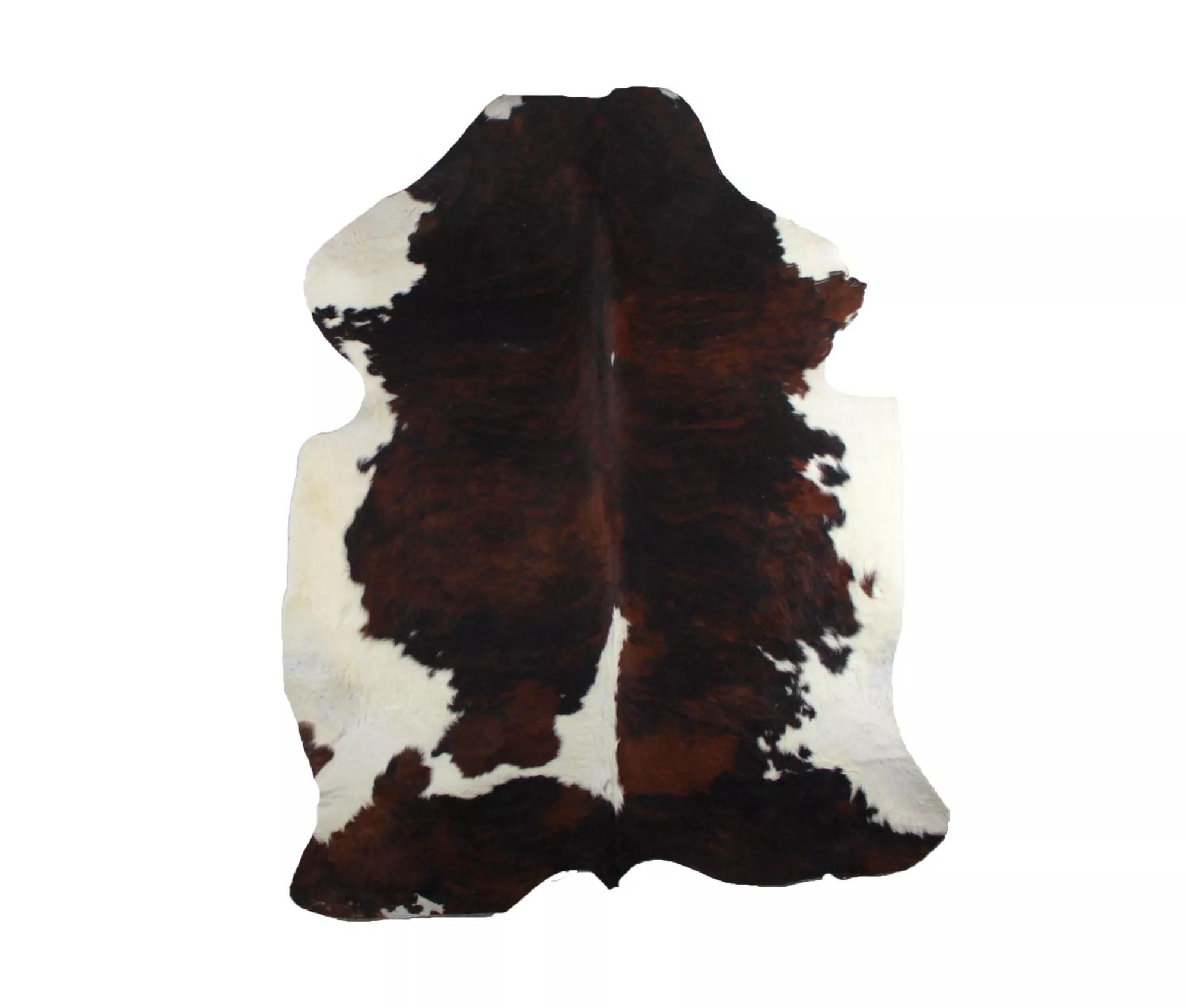 tapis peau de vache type normande nuances de marron et noir blanc