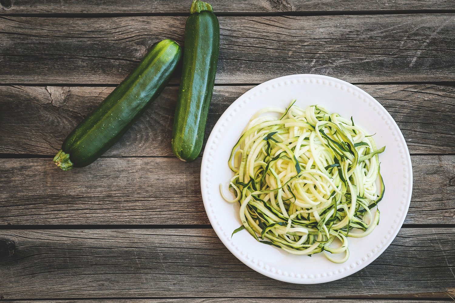 zoodles on a wooden table - zoodles-on-a-wooden-table