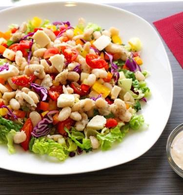 Mediterranean Cannellini Bean Salad on Greens, Tahini Dressing