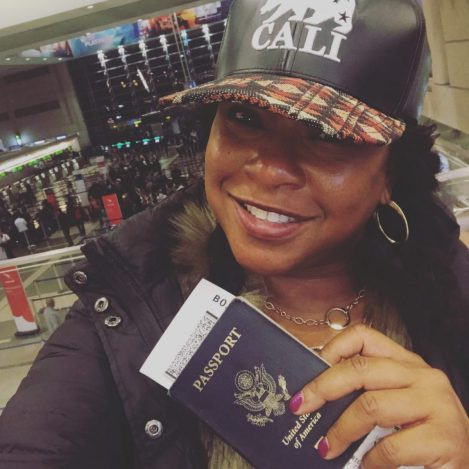 Tuanni Price of Zuri Wine Tasting holding a passport