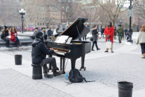 A pianist playing in Washington Square Park, located in Manhattan.