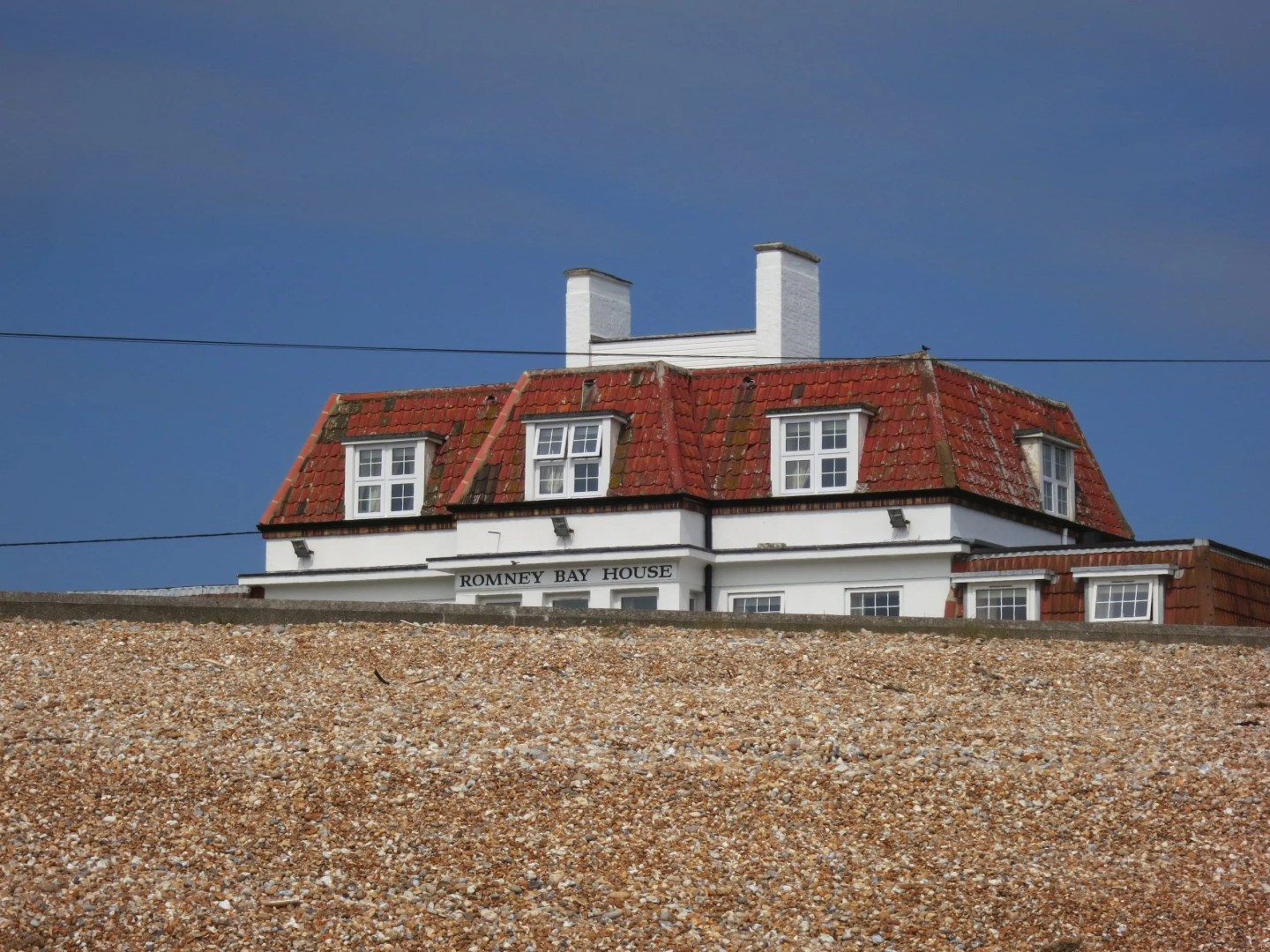 Gravel bank with Romney Bay House Hotel