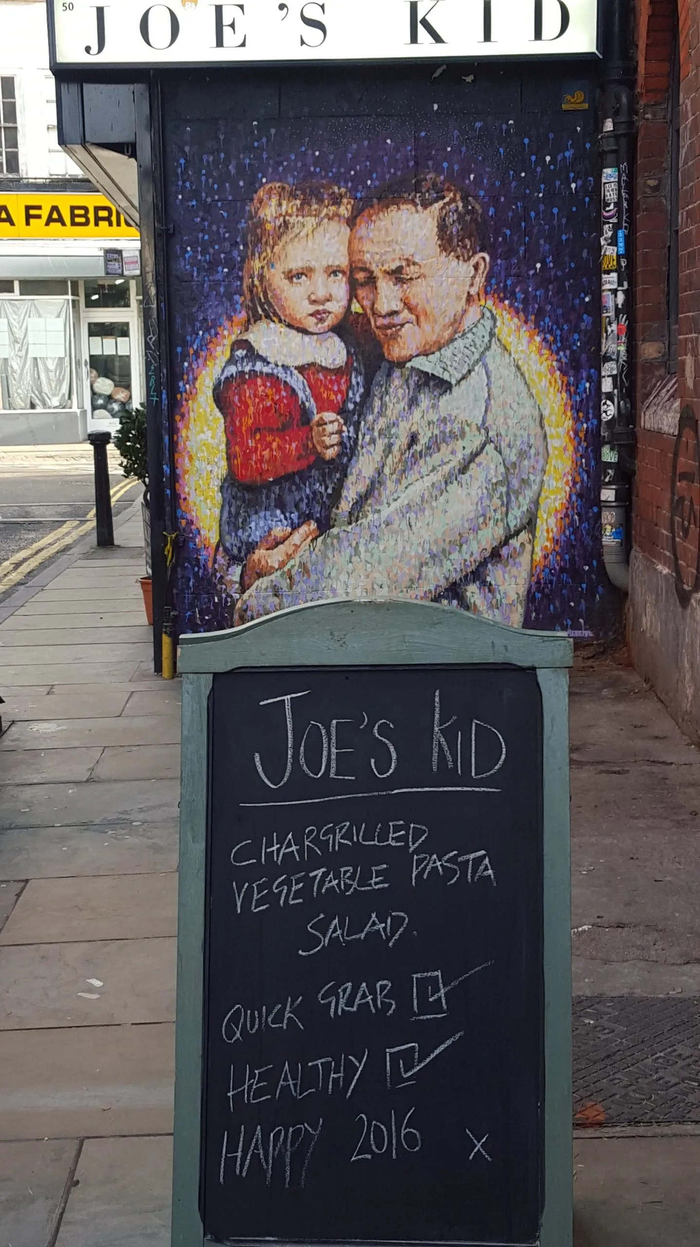 Joe's Kid street art man and child by Jimmy C