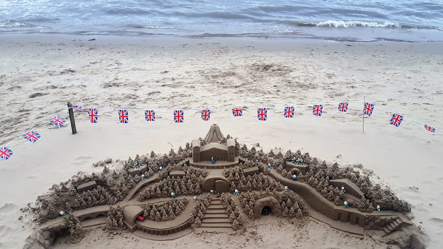 Sandcastle with bunting on the banks of the Thames London